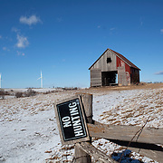 An old barn sits surrounded by alternative energy windmills Sunday, January 1, 2012, in Bridgewater, IA...Photo by Khue Bui