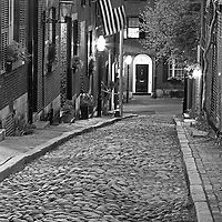 Black and White New England photography of the most photographed cobble stone street in Boston, Acorn Street. Acorn Street, often mentioned as the most frequently photographed street in the United States of America. It is a narrow lane paved with cobblestones that was home to coachmen employed by families in Mt. Vernon and Chestnut Street mansions.<br />