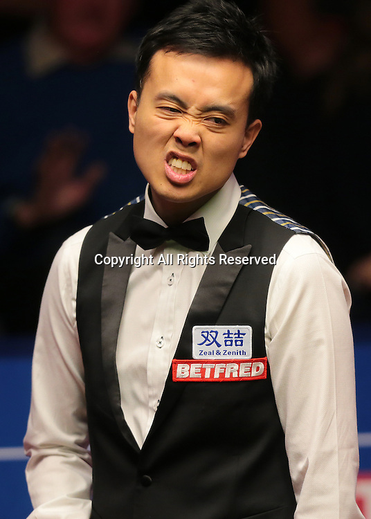 30.04.2016. The Crucible, Sheffield, England. World Snooker Championship. Semi Final, Mark Selby versus Marco Fu.  Marco Fu reacts at his poor positional shot