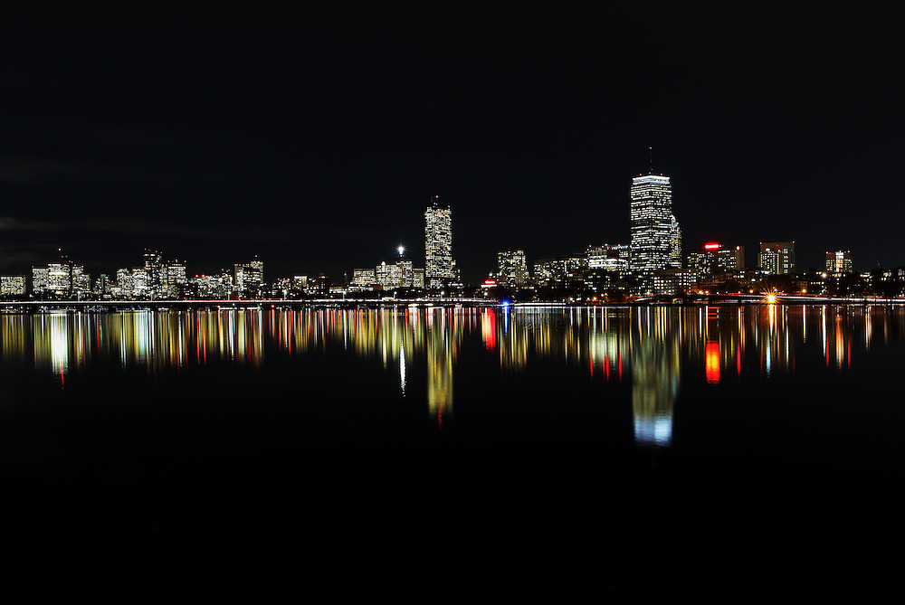 Boston skyline night photography featuring classic landmarks along the Charles River like the famous Prudential Center and 200 Clarendon better known as the John Hancock Tower. This Boston skyline photography image at night reflected in the quiet Charles River is available as museum quality photography prints, canvas prints, acrylic prints, wood prints or metal prints. Fine art prints may be framed and matted to the individual liking and decorating needs:<br />