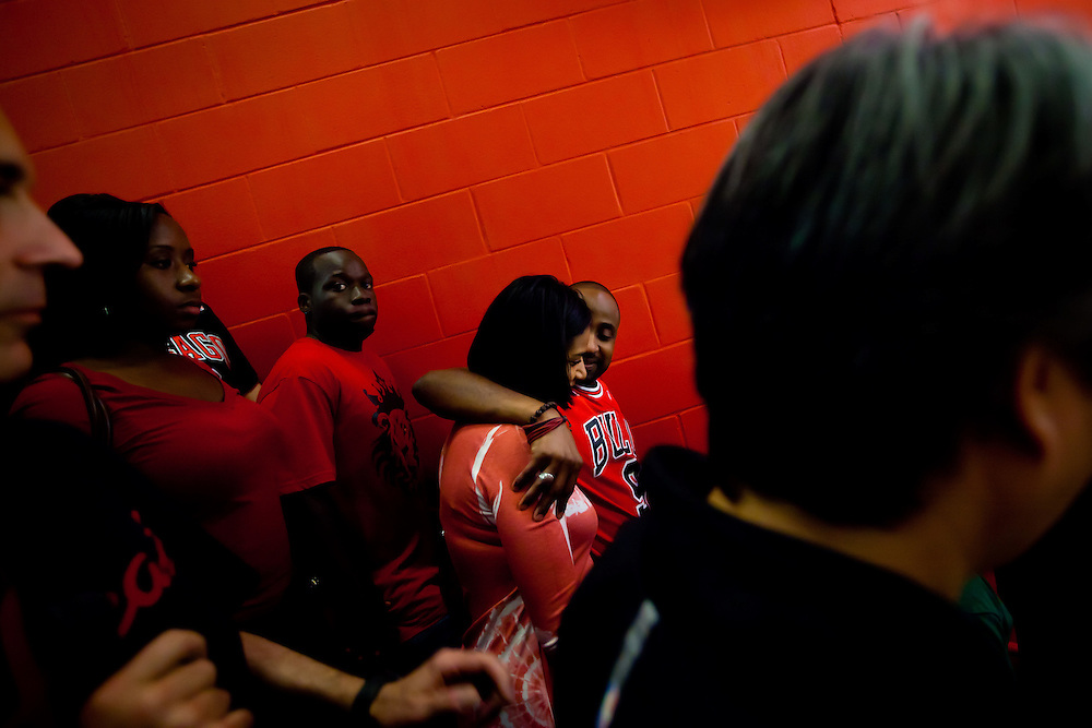 MIAMI, FL -- January 29, 2012 -- Chicago Bulls fans embrace after their 97-93 loss to the Miami Heat at American Airlines Arena in Miami, Fla., on Sunday, January 29, 2012.  (Chip Litherland for ESPN the Magazine)