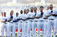 31 March 2011: Players stand on the third baseline during the National Anthem during pre-game ceremony before the San Francisco Giants were defeated 2-1 by the Los Angeles Dodgers  during a sold out game at Dodger Stadium in Los Angeles, California on opening day..***** Editorial Use Only *****