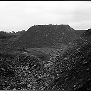 Debris and rock from open pit mining forms the new landscape..India is the third largest producer of coal in the world and accounts for over 60% of India's energy requirements. It is estimated that the coal reserves are likely to last over a 100 years..03/2003