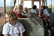 12 year old Pippa Reilly on the bus that will take her to school in Wyalkatchem. Western Australian Wheatbelt. 10 December 2012 - Photograph by David Dare Parker