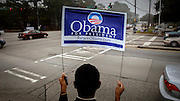 SAVANNAH, GA - FEBRUARY 5: Barack Obama supporter Jamal Toure holds a campaign sign for passing motorist urging them to cast their ballots during Georgia's primary Super Tuesday's presidential election January 5, 2008 in Savannah, Georgia. An enormous cache of delegates is at stake. The two dozen state contests are delivering 1,023 Republican and 1,681 Democratic delegates. (Photo by Stephen Morton/Getty Images)