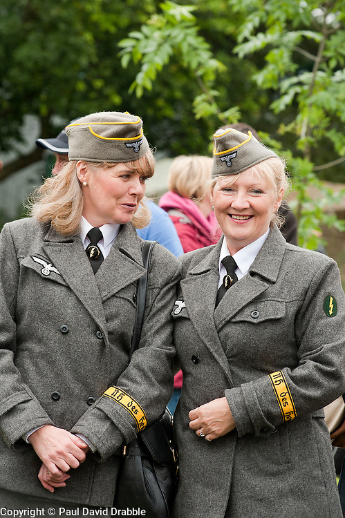 reenactors dressed as German army female signals auxiluaries (Nachrichtenheflrennin des heeres) also nicknamed Blitzm&auml;dchen or lightening girls because of the signals insignia on their uniforms, at Northallerton Wartime Weekend is a fund raising event that happens throughout the Yorkshire market town of Northallerton. .With help of volunteers and local business it has been successful in raising money for the charities.Help for Heroes.Royal British Legion.Bomber Command Memorial Charity .Ben Hyde Memorial Fund.<br />