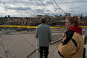 Two emotional Breezy Point residents survey the damage. Breezy Point Queens. Jonah Markowitz/Falcon Photo Agency