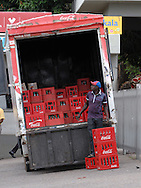 MWANZA, TANZANIA.  A man unloads crates of CocaCola outside the Bugando Medical Center in Mwanza, Tanzania on Wednesday, September 3, 2014.  © Chet Gordon/THE IMAGE WORKS