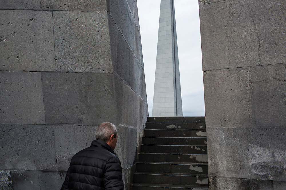 YEREVAN, ARMENIA - APRIL 24: A man visits the Armenian genocide memorial before a program of commemoration on April 24, 2015 in Yerevan, Armenia. Armenians today are marking the one hundredth anniversary of events generally considered to be the start of a campaign of genocide against minority ethnic Armenians living in present-day eastern Turkey by the Ottoman government over fears of their allegiance during World War I. (Photo by Brendan Hoffman/Getty Images) *** Local Caption ***