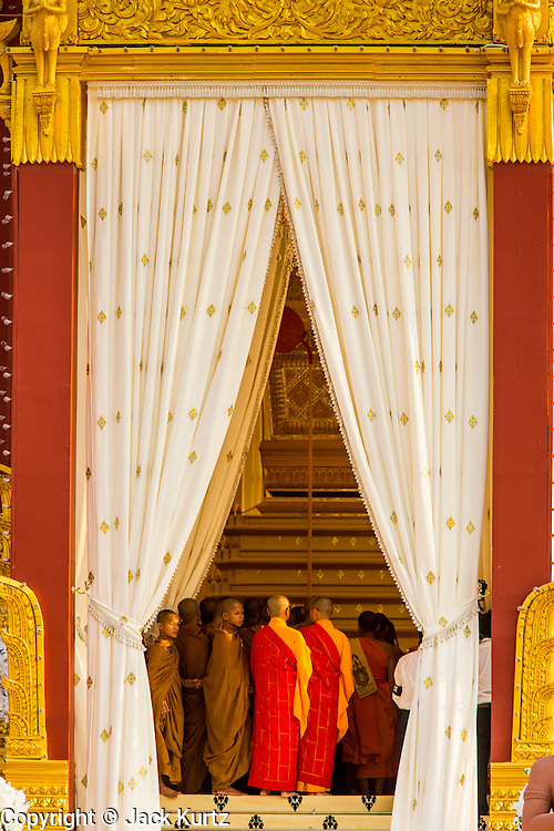 "03 FEBRUARY 2013 - PHNOM PENH, CAMBODIA:  Buddhist monks at the final Buddhist chanting service for former Cambodian King Norodom Sihanouk in the crematorium built for the King's funeral at the National Museum in Phnom Penh. Norodom Sihanouk (31 October 1922 - 15 October 2012) was the King of Cambodia from 1941 to 1955 and again from 1993 to 2004. He was the effective ruler of Cambodia from 1953 to 1970. After his second abdication in 2004, he was given the honorific of ""The King-Father of Cambodia."" He served as puppet head of state for the Khmer Rouge government in 1975-1976, before going into exile. Sihanouk's actual period of effective rule over Cambodia was from 9 November 1953, when Cambodia gained its independence from France, until 18 March 1970, when General Lon Nol and the National Assembly deposed him. Upon his final abdication in 2004, the Cambodian throne council appointed Norodom Sihamoni, one of Sihanouk's sons, as the new king. Sihanouk died in Beijing, China, where he was receiving medical care, on Oct. 15, 2012. His cremation will take place on Feb. 4, 2013. Over a million people are expected to attend the service.    PHOTO BY JACK KURTZ"
