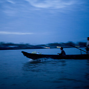 Vietnamese farmers head to a floated market on the Mekong River in the early morning.