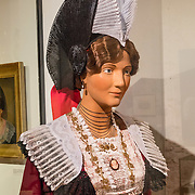 Mannequin of 1824 woman in traditional Appenzell folk costume, a variation of the Swiss National folk dress. Appenzell Museum, Switzerland, Europe. Appenzell Museum, which is in the town hall, shows a cross section of the Swiss Canton's history and culture. Appenzell village is in Appenzell Innerrhoden, Switzerland's most traditional and smallest-population canton (second smallest by area).