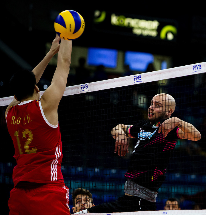 Marcel Keller Gil of Portugal spikes the ball versus China at a World League Volleyball match at the Sasktel Centre in Saskatoon, Saskatchewan Canada on June 24, 2016.