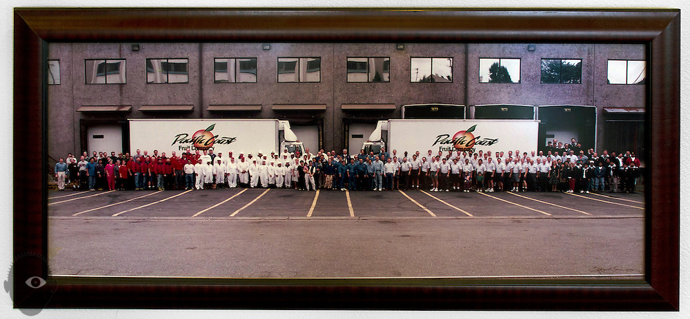 A picture of the exterior of the Pacific Fruit Co. complete with trucks and employess hangs in Emil Nemarnik's office.