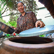 CAPTION: Bui Huong covers all fresh water to prevent mosquitoes from breeding close to her house. LOCATION: Long Tuyen, Can Tho, Vietnam. INDIVIDUAL(S) PHOTOGRAPHED: Bui Huong.