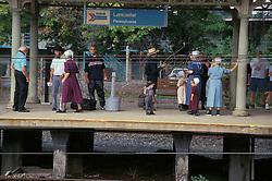 amish family awaits amtrak railroad
