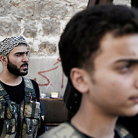 SYRIA, ALEPPO. Rebels fighters stand in a frontline position in Aleppo on September 25, 2012. ALESSIO ROMENZI