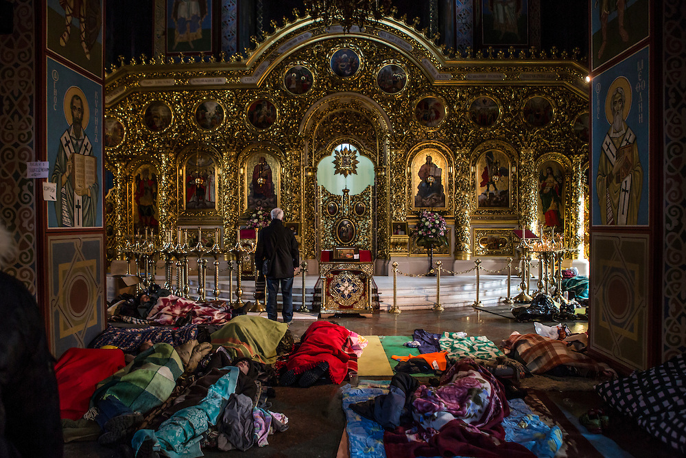KIEV, UKRAINE - FEBRUARY 19: Anti-government protesters sleep on the floor inside the Mikhailovsky Monastery, which has been converted into a makeshift hospital, on February 19, 2014 in Kiev, Ukraine. After several weeks of calm, violence has again flared between police and anti-government protesters, who are calling for the ouster of President Viktor Yanukovych over corruption and an abandoned trade agreement with the European Union. (Photo by Brendan Hoffman/Getty Images) *** Local Caption ***