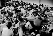 Refugees, displaced by Mt. Merapi's worst eruption in over 100 years, are sleeping at close quarters without any family privacy at all.  Maguwoharjo Stadium in Sleman, Java, Indonesia.