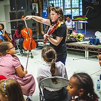 Lucy Maguire leads a rehearsal of The Nucleo Project, a programme that uses music to enrich the lives of 140+ children in West London. Children receive free music tuition and instruments, and attend at least four days a week. The Nucleo is a programme of social action through music inspired by the Venezuelan El Sistema. It is based on the principle that by striving towards musical excellence it is possible to achieve social change. London, Sep. 10, 2014 (Photos/Ivan Gonzalez)