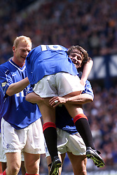 Tugay carries goal-scorer McCann after their third goal, during a Rangers v Dunfermline game in August 2000..