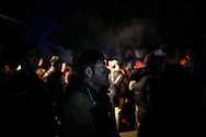 02 December 2015, Greece, Idomeni - Migrants and refugees wait to cross the Greek-Macedonian border near the village of Idomeni, Greece.