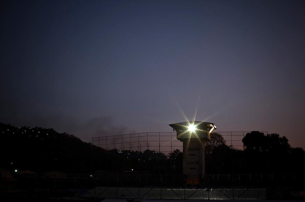 A guard tower at night at Esperanza prison in San Salvador, El Salvador.