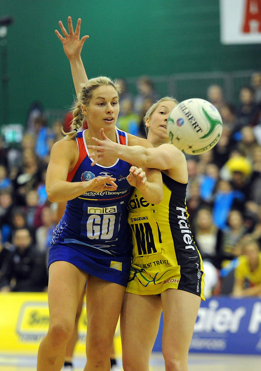 Mystics' Julie Corletto, left contests the ball with Pulse's Camilla Lees in the ANZ Championship netball, Arena Manawatu, Palmerston North, New Zealand, Sunday, May 18, 2014. Credit:SNPA / Ross Setford