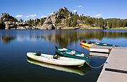 SD00074-00...SOUTH DAKOTA - Boats docked on Sylvan Lake in Custer State Park.