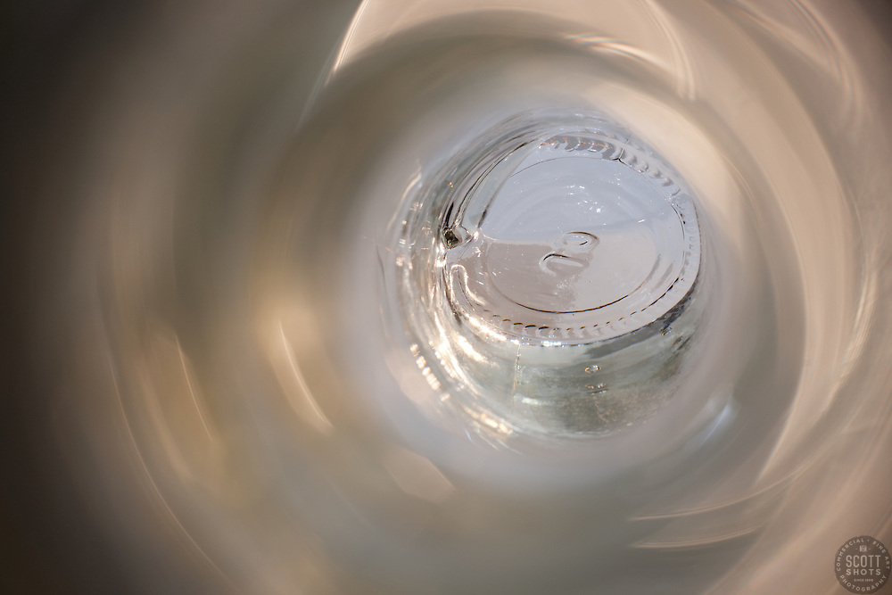 """Beauty at the Bottom: Tequila 3"" - This image is a photograph of a tequila bottle looking right down the mouth of the bottle."