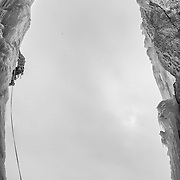 Doug Heinrich climbing pitch three of the Weeping Pillar, Upper Weeping Wall, Jasper National Park, Alberta Canada