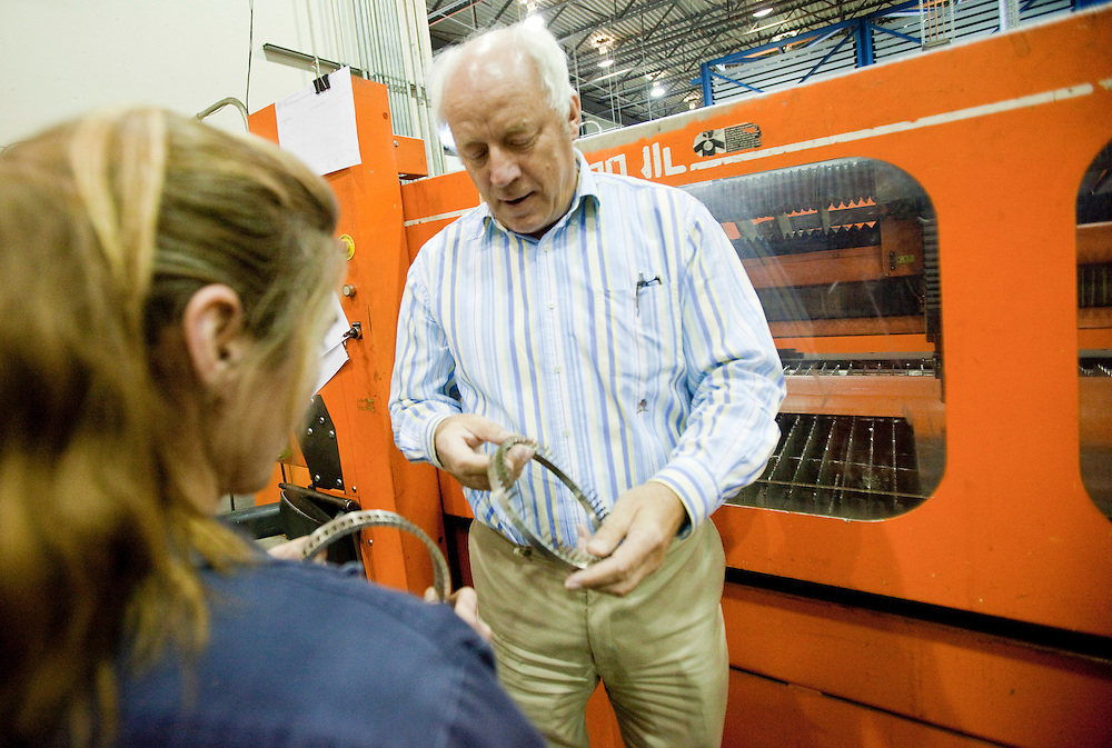 London, Ontario.: April 15, 2011 --  Jan Maarschalkerweerd, President of Abuma Manufacturing limited inspects parts with a worker at their London, Ontario plant, April 15, 2011.<br /> (GEOFF ROBINS for National Post)