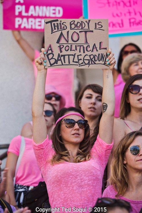 More than 200 planned Parenthood supporters, staff and volunteers held a rally in downtown L.A. to speak out for women's access to reproductive health care on ``National Pink Out Day.''