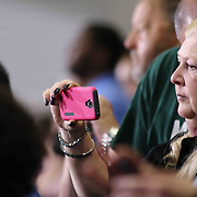 Family and friends takes photos during McKean 49th commencement exercise Saturday, June 06, 2015, at The Bob Carpenter Sports Convocation Center in Newark, Delaware.
