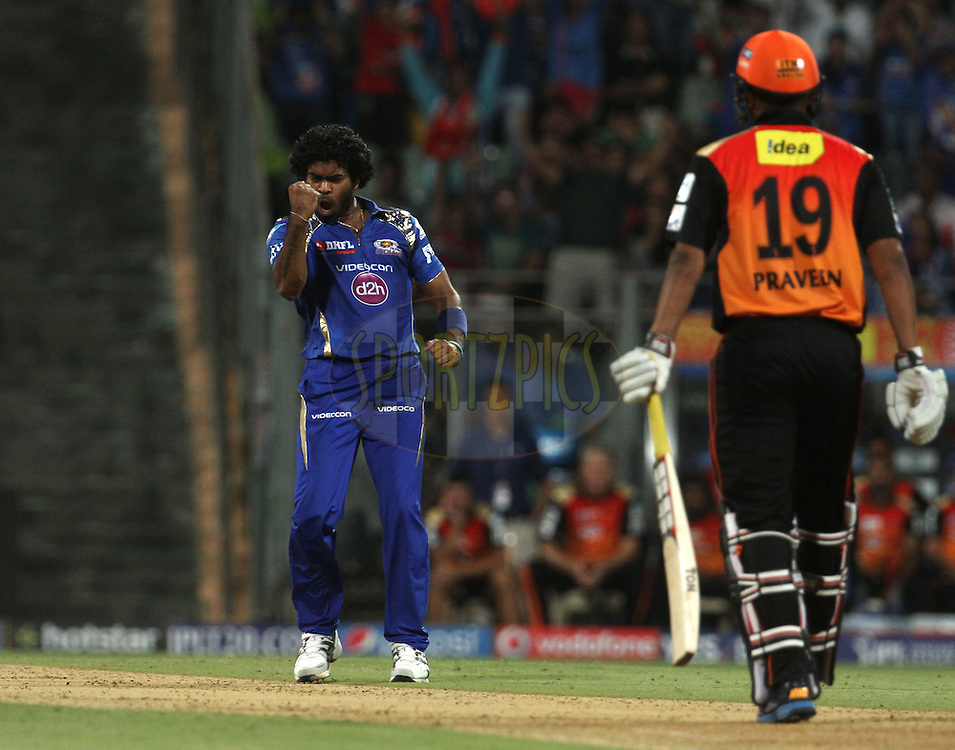 Mumbai Indians player Lasith Malinga celebrates the wicket of Sunrisers Hyderabad player Praveen Kumar during match 23 of the Pepsi IPL 2015 (Indian Premier League) between The Mumbai Indians and The Sunrisers Hyderabad held at the Wankhede Stadium in Mumbai India on the 25th April 2015.<br /> <br /> Photo by:  Vipin Pawar / SPORTZPICS / IPL