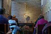 ADORATION CHAPEL -- Members of Mary Queen of Heaven Parish in West Allis spend time before the Blessed Sacrament inside an adoration chapel at the church. Adoration has been held at the church for 18 years. (Photo by Sam Lucero)