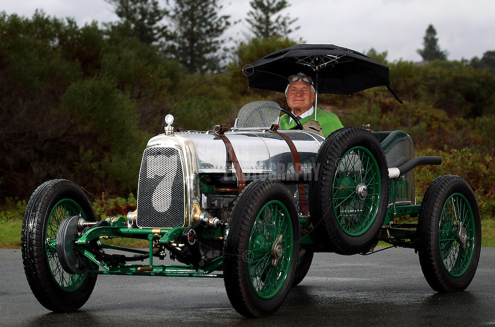 PERTH, AUSTRALIA - JUNE 19: Peter Briggs poses with his 1923 Aston Martin on June 19, 2012 in Perth, Australia. (Photo by Paul Kane)