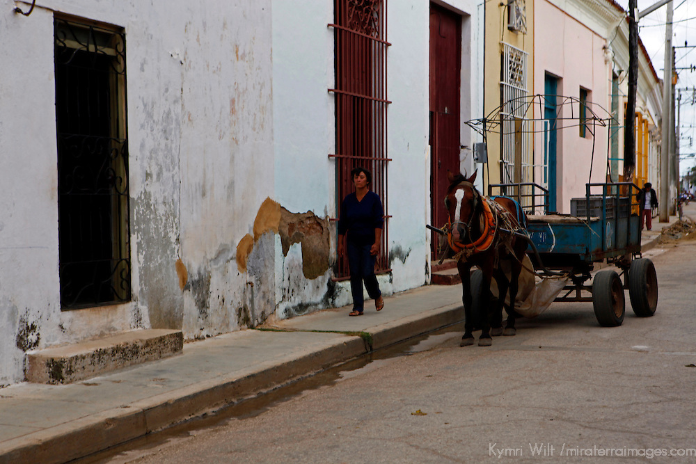 Central America, Cuba, Remedios.Horse and cart and walking man in Remedios.