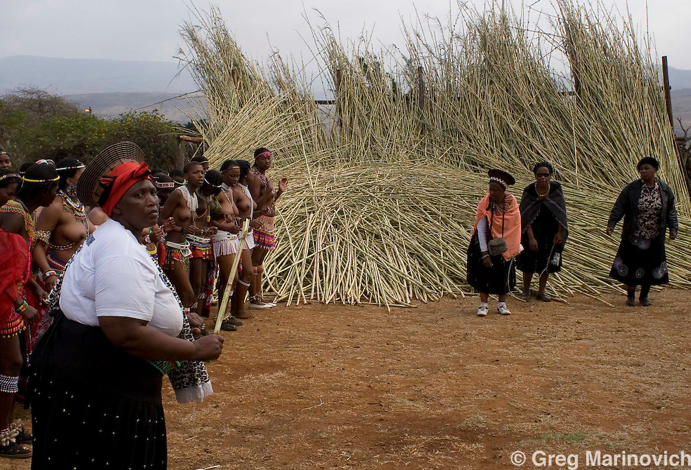 A married woman leads girls in dance for the Zulu king at the Enyokeni  Zulu royal palace in Nongoma, KwaZulu Natal, South Africa Sept 9, 2007. Thousands of virgin girls attend the annual Reed Dance at the Enyokeni palace from which the Zulu King Zwelethini may choose a bride. From nrext year, virgin testing or girls under 16 is to be made illegal in a new child protection law.  Photo Greg Marinovich / Bloomberg News