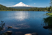 It is the floating duck, leaving trails behind it, that makes this image come alive. Terillium lake is located about 7 miles southeast of Mount Hood, near highway 26; it is in the background. Oregon.