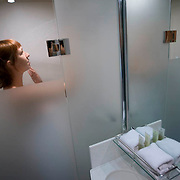 The Ghan.  Passenger Rebecca Barnes enjoys a shower in the Platinum Service cabin aboard the Ghan. Image © Arsineh Houspian/Falcon Photo Agency.
