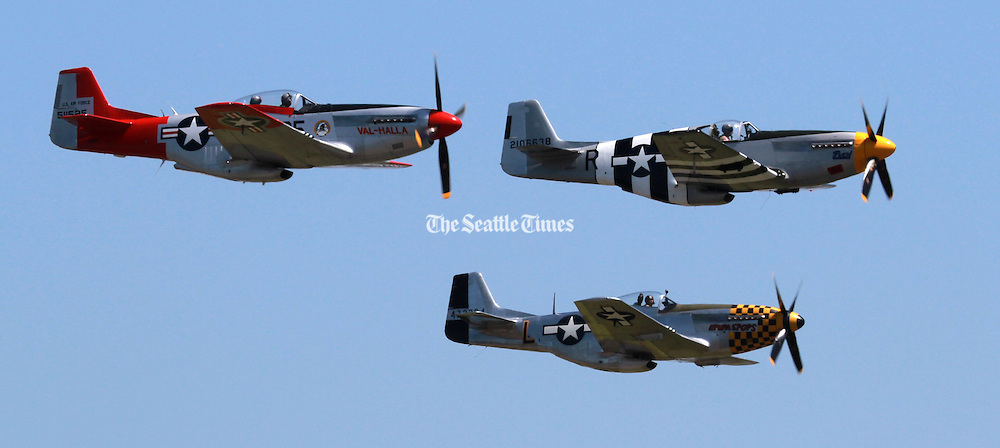 A restored P-51B Mustang that flew in the D-Day invasion flies over Paine field on the 70th anniversary of D-Day. The other two planes are P-51D Mustangs, but weren't involved in D-Day. The D-Day plane has &quot;invasion stripes&quot; which let allied planes know it was a friendly.<br /> <br /> Ken Lambert / The Seattle Times