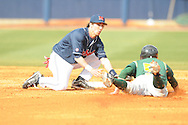 Ole Miss' Blake Newalu (6) tags out Wright State's Corey Davis (5) at Oxford University Stadium in Oxford, Miss. on Saturday, February 19, 2011.