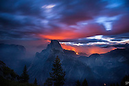 The Meadow Fire burns at dawn near Half Dome in Yosemite National Park early Monday September 8, 2014. The Meadow Fire was one of four  large fires that burned in and around Yosemite National Park during summer of 2014. <br /> <br /> Long exposure image.