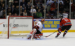 Apr 3, 2007; East Rutherford, NJ, USA; New Jersey Devils center John Madden (11) scores the game-winner on Ottawa Senators goalie Ray Emery (1) during the overtime shootout at Continental Airlines Arena in East Rutherford, NJ.