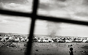 Dollo Ado, Ethiopia.October2011<br /> I the &quot;Kobe&quot; refugeecamp, more than 25.000 people are living. Due to the open, dry area - the camp is daily hit by large dust storms, that makes living there even more difficult than it already is. <br /> &rdquo; The drought in the horn of Africa is affecting more than 4.5 million people in Ethiopia. In addition, more than 140.000 refugees from Somalia have settled in camps in the border region between Somalia and Ethiopia. In the area around the border city Dollo Ado, four large refugee camps are already over crowded. A fifth camp is under construction due to the big influx still taking place. Many of the refugees are children, arriving severely malnutritioned. The mortality rate among small children has been brought down, but still children are dying on a daily basis...<br /> The four camps &ndash;Hilaweyn,Kobe, Malkadida and Bokomayo are now hosting more than 120.000 refugees and more are coming daily....