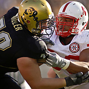 SHOT 11/27/09 3:00:32 PM - Nebraska Cornhuskers defensive tackle Ndamukong Suh (#93) battles Colorado's Ryan Miller (#73) while rushing the passer during the first half of their game at Folsom Field in Boulder, Co. Nebraska won the game 28-20. Suh is one of the top players in the nation, a candidate for the Heisman trophy and a likely top NFL draft pick. (Photo by Marc Piscotty / © 2009)