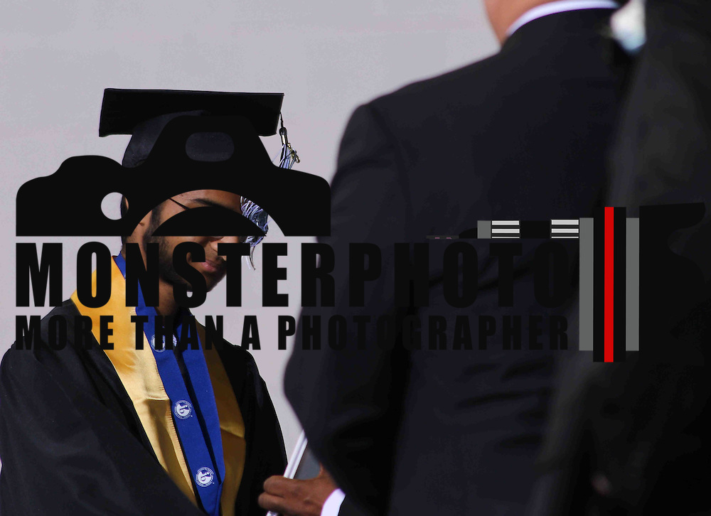 John Dickinson Valedictorian Habibullah Aslam receives his diploma during 55th commencement exercises Saturday, June 06, 2015, at The Bob Carpenter Sports Convocation Center in Newark, Delaware.