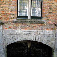 Europe, Belgium, Brugges. Canal gate house.