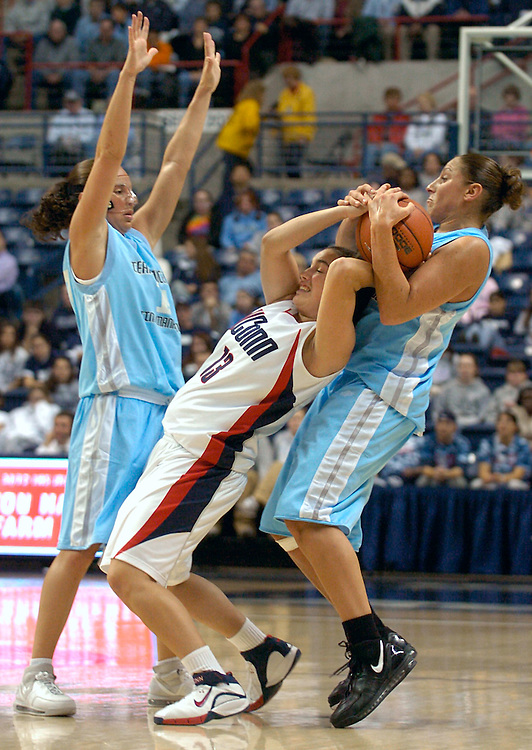 Connecticut's Jacquie Fernandes, center, is guarded by Team Concept's Diana Taurasi, right, and Sue Bird in the second half of the basketball game in Storrs, Conn., Thursday, Nov. 2, 2006  (AP Photo/Jessica Hill)
